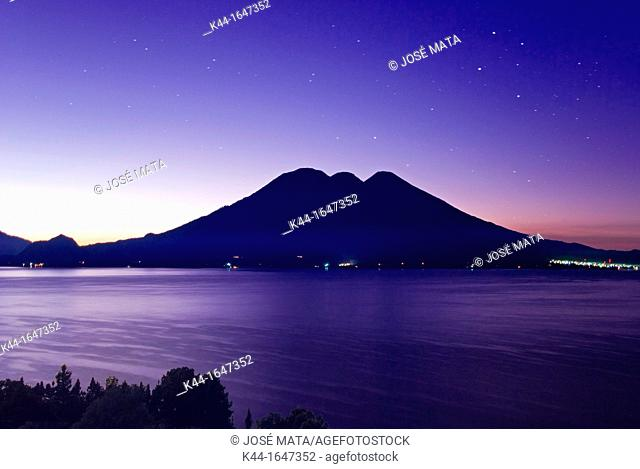 Sunrise at Lake Atitlán in Guatemala with volcanoes Tolimán and Atitlán in the background