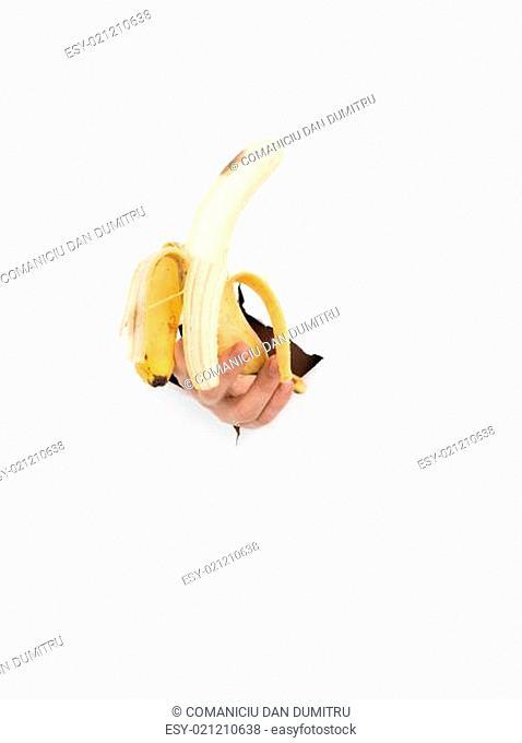 male hand holding a peeled banana