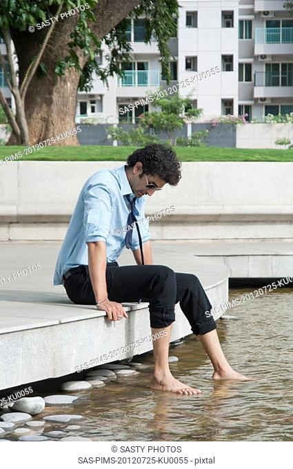 Businessman thinking at poolside