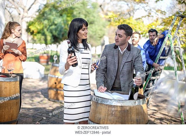 Sales people preparing wine selling event at wine estate
