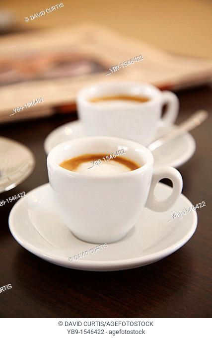 Two cups of espresso coffee on a table