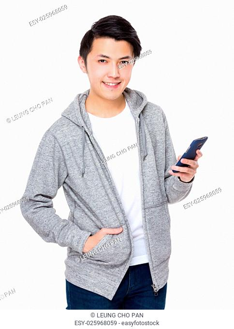 Asian Young Man use of the cellphone