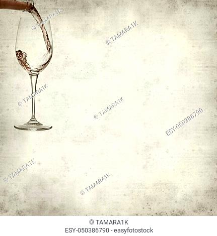 textured old paper background with pouring rose wine