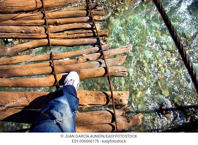A wooden bridge over the River Oued in Ourika valley between the mountains of Morocco