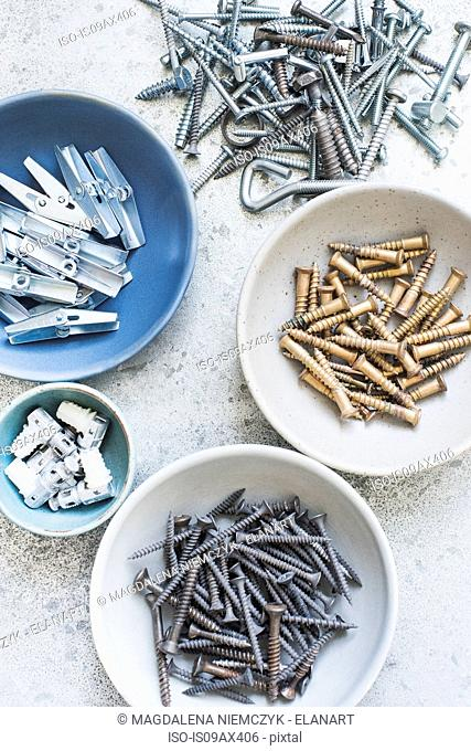Bowls of screws, nails, pegs and hooks