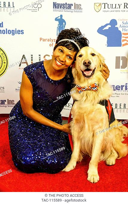 Shanda Taylor Boyd and her dog Timber pose for a photo at The Vettys Inaugural Ball at the Hay-Adams Hotel on January 20, 2017 in Washington, D.C