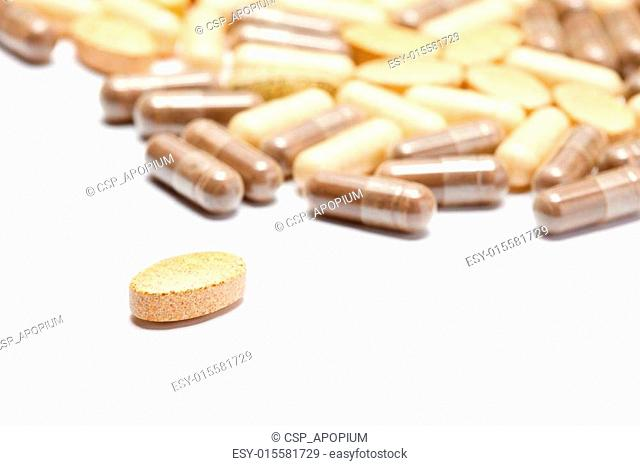 Medicinal pills piled up a bunch