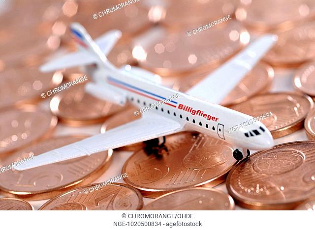 Miniature airplane and euro cent coins, no frills airlines