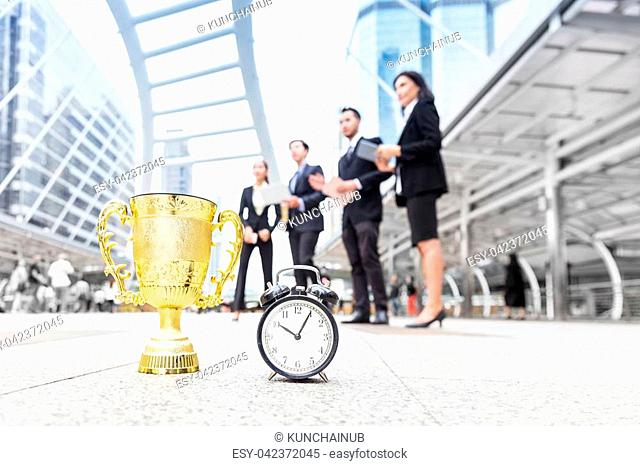 success business team, winning gold prize in limited time, stand in downtown center of business zone