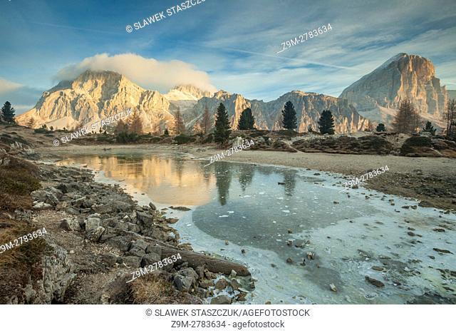 Autumn sunrise at frozen lake Limides, Dolomites, Italy