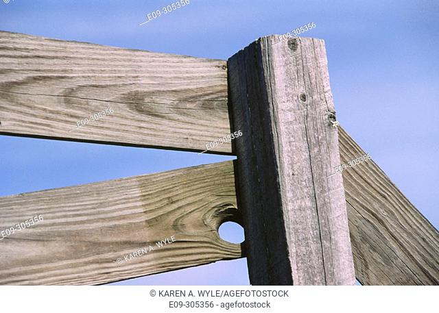 closeup of wooden fence against soft blue sky, rural Indiana, USA