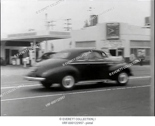 Police car speeding down city street