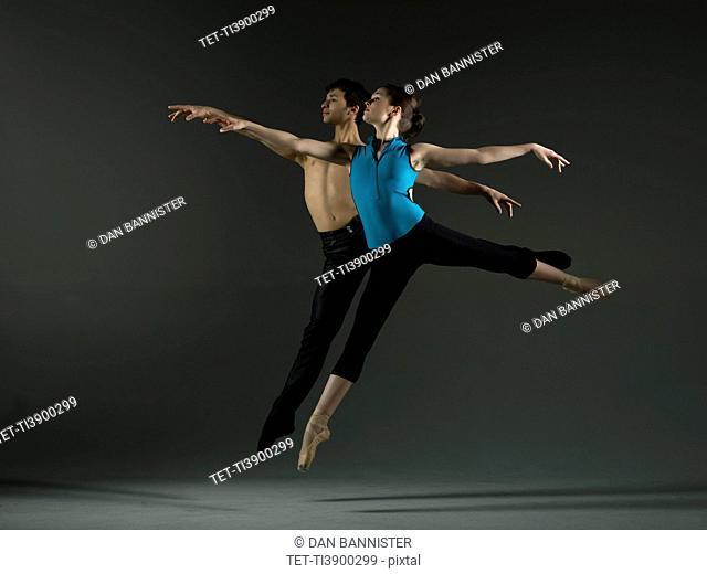 Pair of ballet dancers practicing