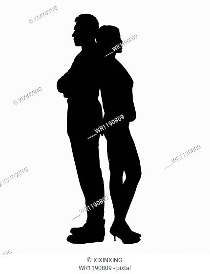 Silhouette of businessman and businesswoman standing back to back