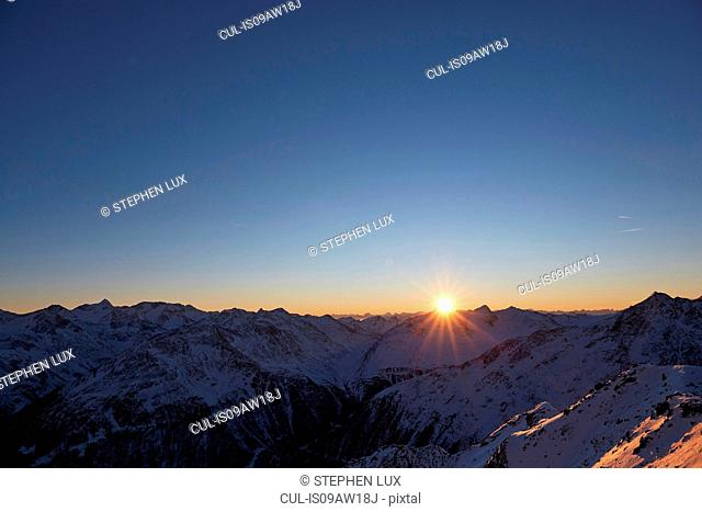 Elevated view of sunset over snow covered mountains, Gaislachkogel, Soelden, Tyrol, Austria