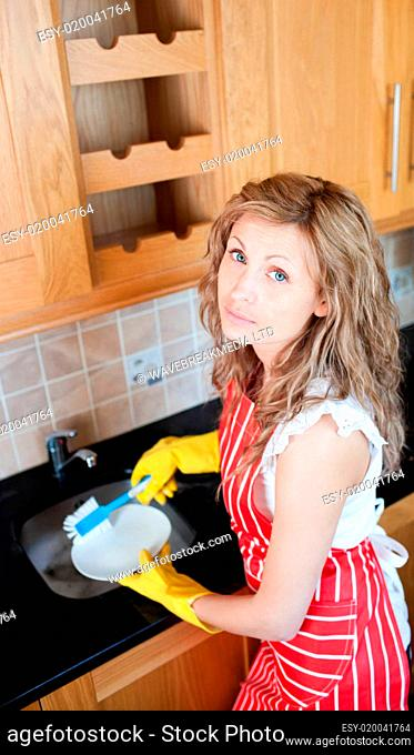 Unhappy woman doing the dishes