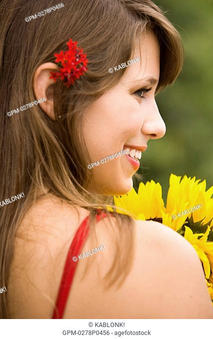 Mid adult woman holding flower