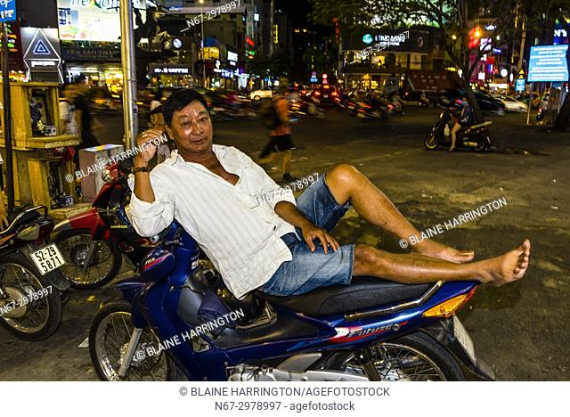 Two-wheeled traffic in Ho Chi Minh City (Saigon), Vietnam. There are over four million motorbikes in the city