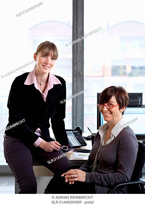 Two Women looking over some paper work in an Office
