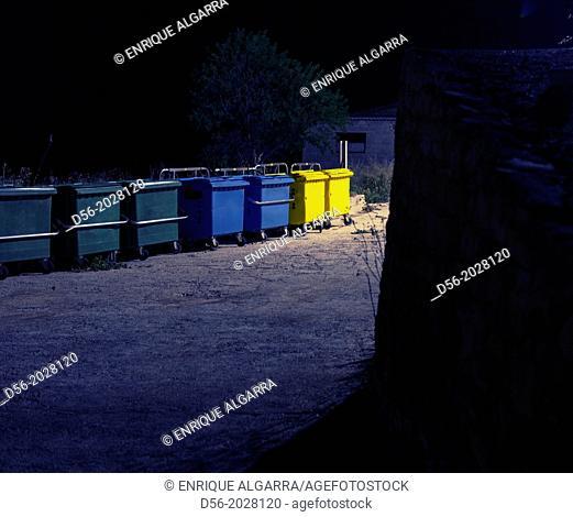 Rubbish containers at night, Cretas, Teruel province, Spain