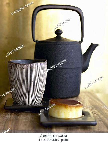 Old Black Tea Pot and Dessert  Studio Shot