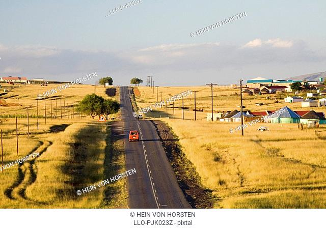 The road to Elliot with traditional Xhosa settelments and grasslands. Eastern Cape Province, South Africa