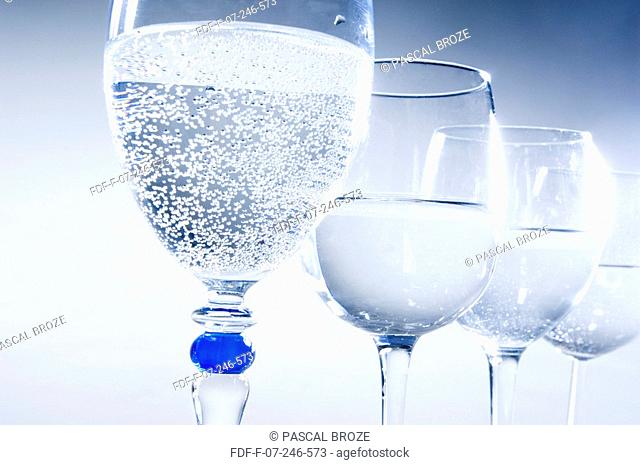 Close-up of four glasses of mineral water