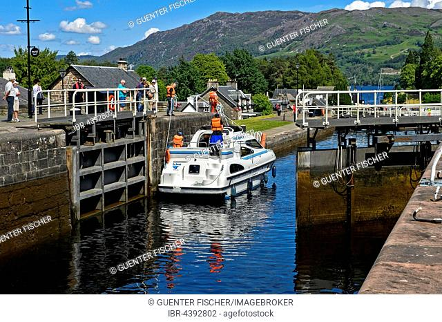 Motorboat passing through lock in Caledonian Canal, Loch Ness inflow, Fort Augustus, Scotland, UK