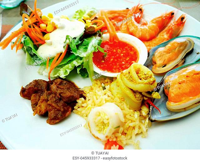 Thai people serve cuisine on plate at food buffet service in restaurant of Hotel in Thailand