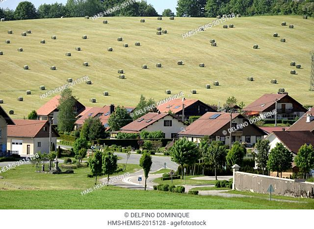 France, Doubs, Haut Doubs, Le Barboux, lottissement in the village outskirts and hay bales in the surrounding pastures