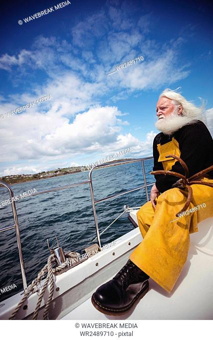 Fisherman sitting on fishing boat