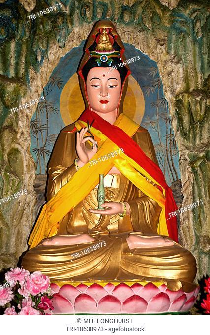 Colourful Buddha statue, Guan Yin Temple, Jinsuo Island, near Dali, Yunnan Province, China