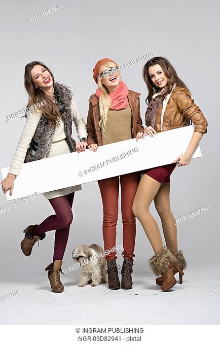 Teenage ladies having fun with empty board