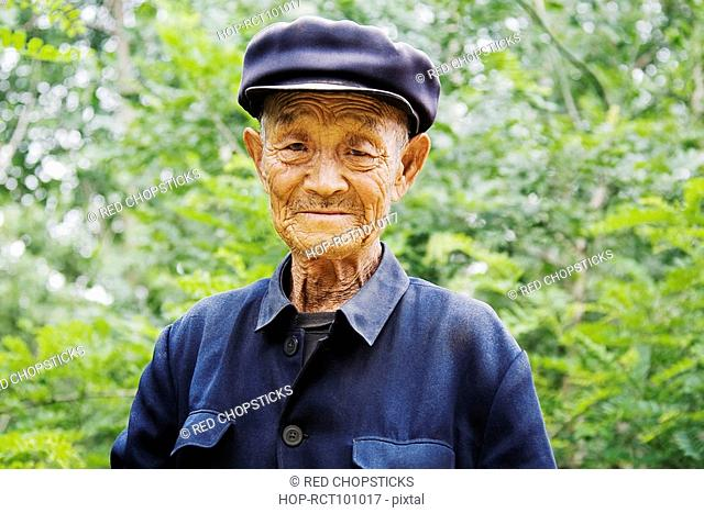 Portrait of a senior man wearing a flat cap, Zhigou, Shandong Province, China