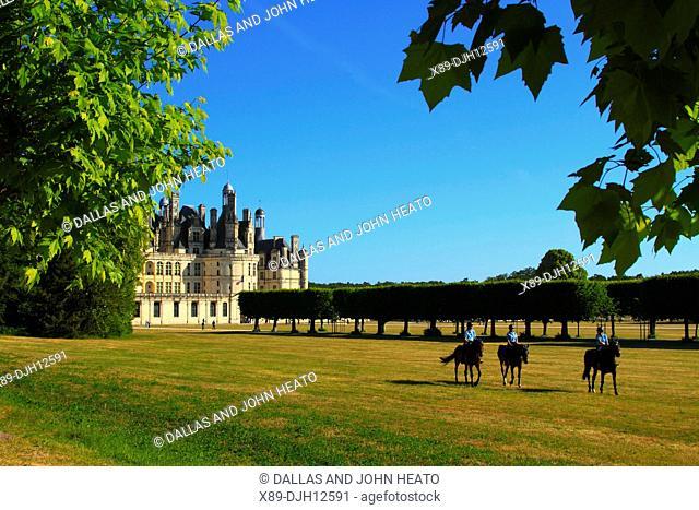France, Loire Valley, Loir-et-Cher, Chambord, Château de Chambord, South Façade, Equestrian Training in the Grounds