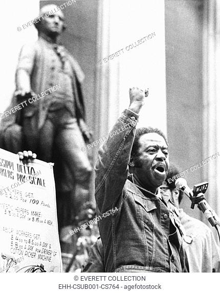 Rev. Ralph Abernathy speaks with a clenched fist on Wall Street on April 5, 1971. 4000 protestors marched in the Financial District demanding a guaranteed...