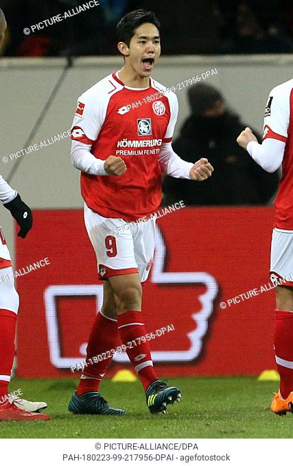 23 Febuary 2018, Germany, Mainz: German Bundesliga soccer match between FSV Mainz 05 and VfL Wolfsburg, Opel Arena. Mainz's Yoshinori Muto celebrates after his...