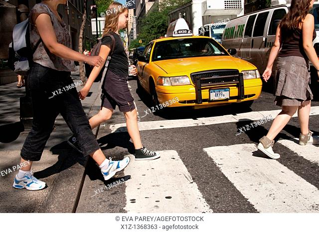 Traffic and passer-by in 50th Street in Midtown Manhattan, New York City