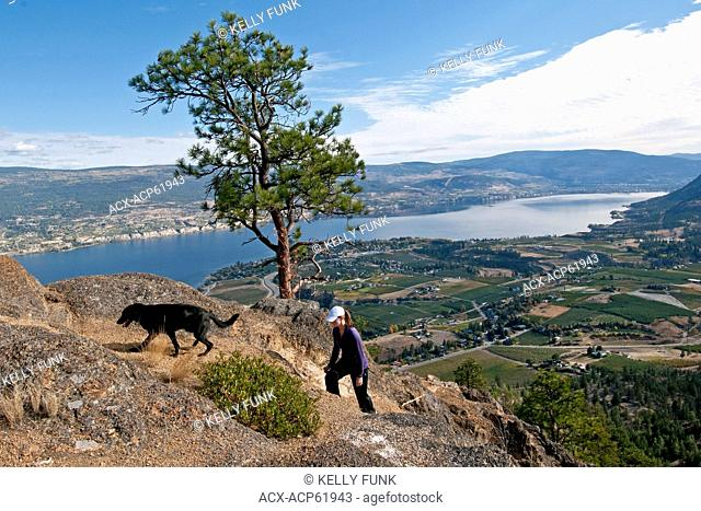 A girl and her dog hike up the South side of Giant's Head mountain in Summerland, British Columbia, Okanagan region, Canada