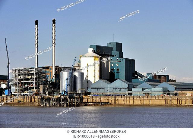 The Tate and Lyle factory on the banks of the River Thames in East London, United Kingdom, Europe