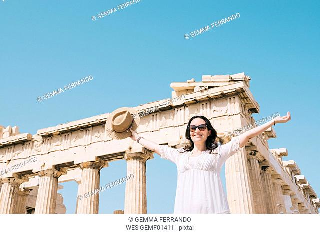 Greece, Athens, happy woman visiting the Parthenon temple on the Acropolis