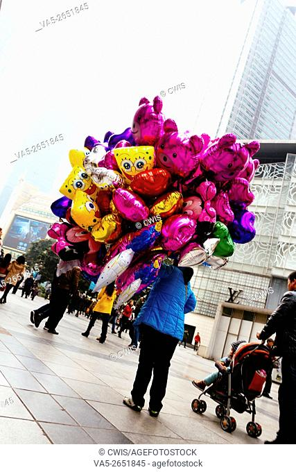 Chongqing, China - The view of Chongqing Jiefangbei Business center, a balloon seller
