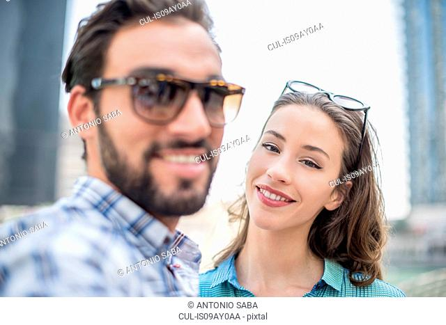 Tourist couple posing for selfie, Dubai, United Arab Emirates