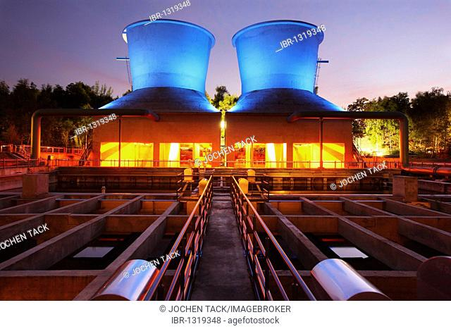 Illuminated cooling towers, water park in Westpark Industrial Park at Centennial Hall, Bochum, North Rhine-Westphalia, Germany, Europe