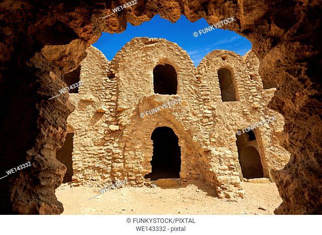 The northern Sahara ghorfa storage graneries of the traditional Berber mud brick fortified Ksar of Hedada or Hadada, near Tetouin, Tunisia