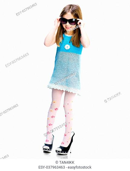 Cute little girl in big shoes. Isolated on white background