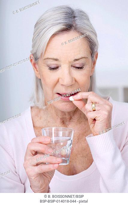 Elderly person taking medication