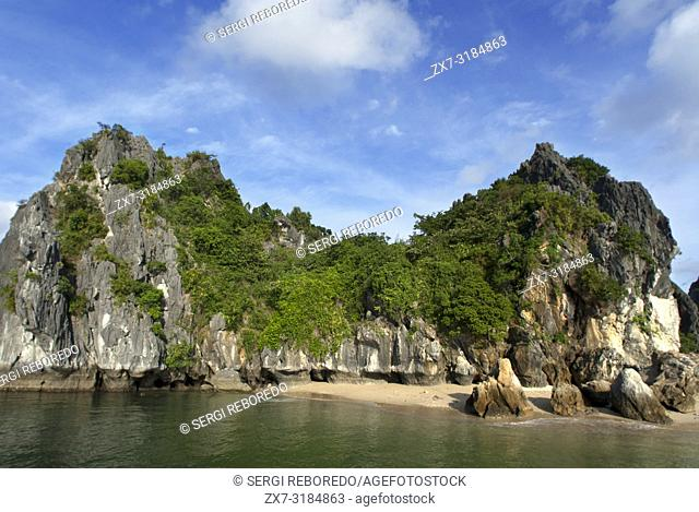 Secluded beach in isolated island in Ha Long Bay, Vietnam. Quiet tropical beach, Cat Ba National Park, Ha long,Halong Bay, Vietnam