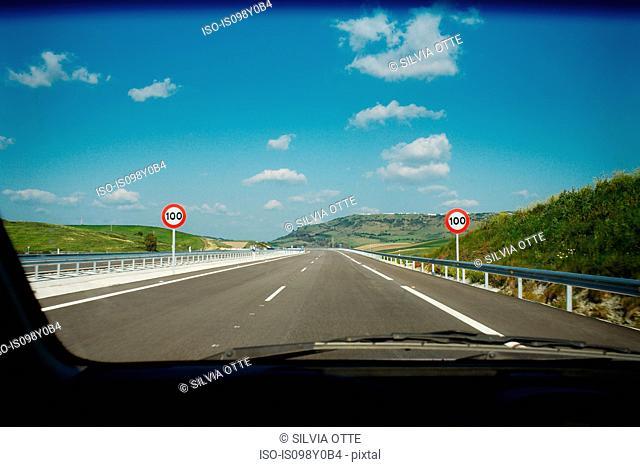 View of road through car windscreen