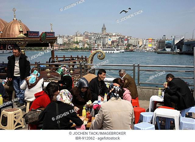 Restaurants, snack bars offering fish at the Golden Horn at Galat Bridge, Istanbul, Turkey